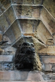 Gargoyle below oriel window