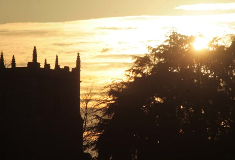 golden sky with church tower