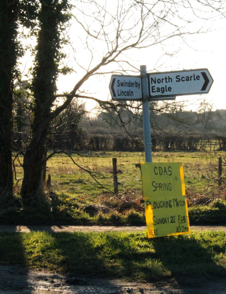 signpost with ploughing match sign