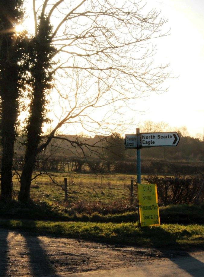 signpost with sunburst