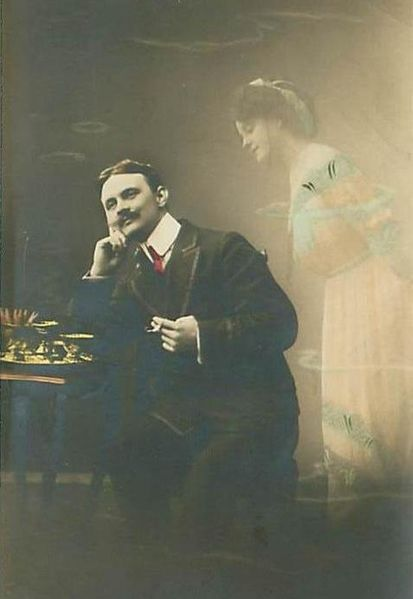 A daydreaming gentleman; from an original 1912 postcard published in Germany. Image from Wikimedia.