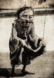 freaky puppet in vintage sepia