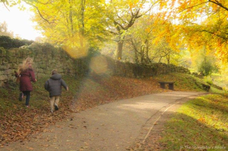 sunlit path with children