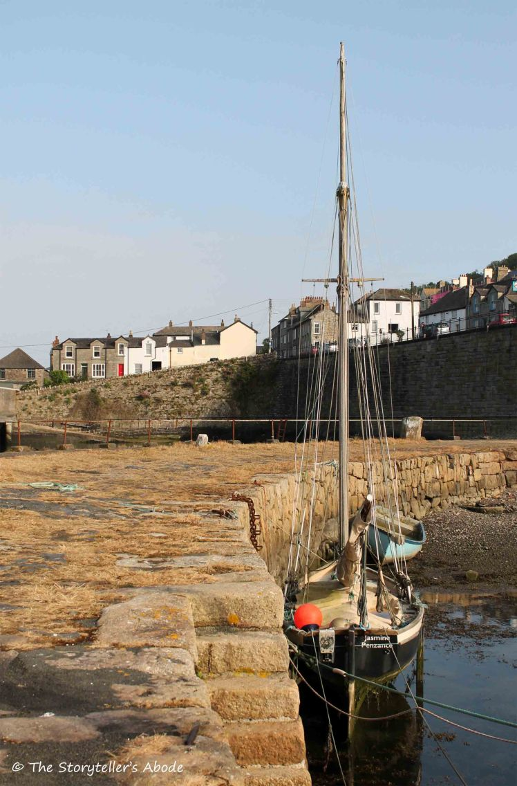 boat by harbour wall