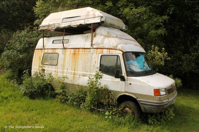 overgrown camper van