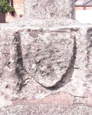 Worn crest on market cross